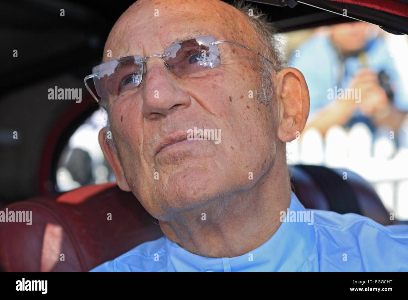 Sir Stirling Moss casts a pensive look at the weather / Goodwood Revival / Goodwood / West Sussex / UK - Stock Image