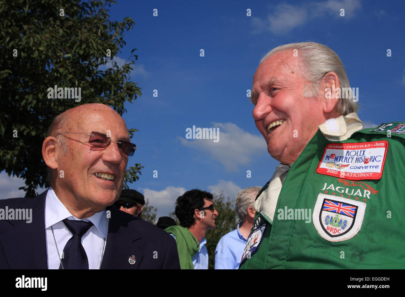 Sir Stirling Moss enjoys a moment with Norman Dewis, former Jaguar works driver and development engineer / Goodwood - Stock Image