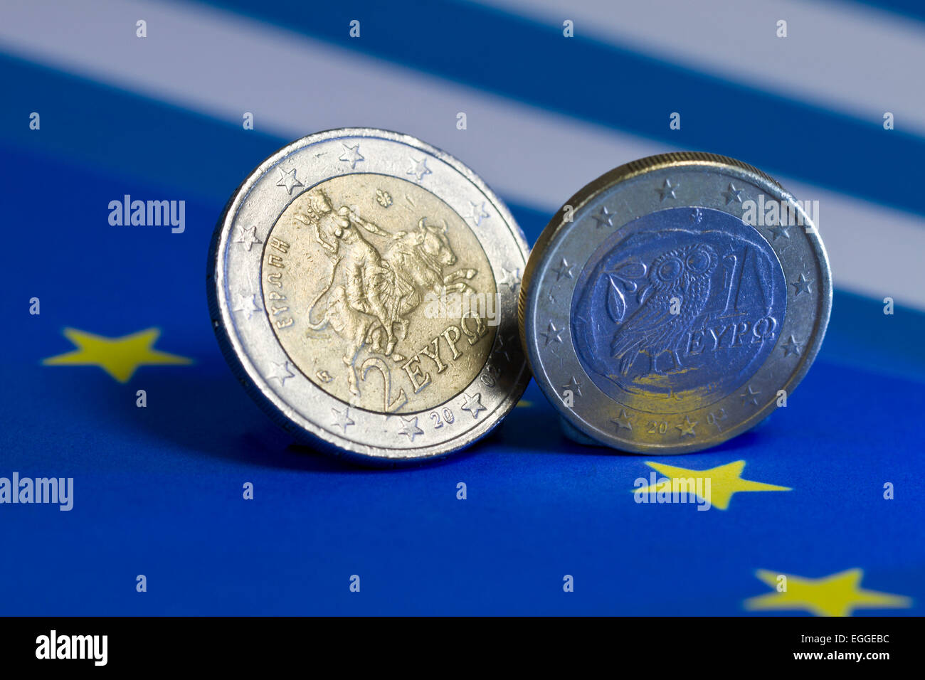 one and two Euro coins from Greece on flags - Stock Image