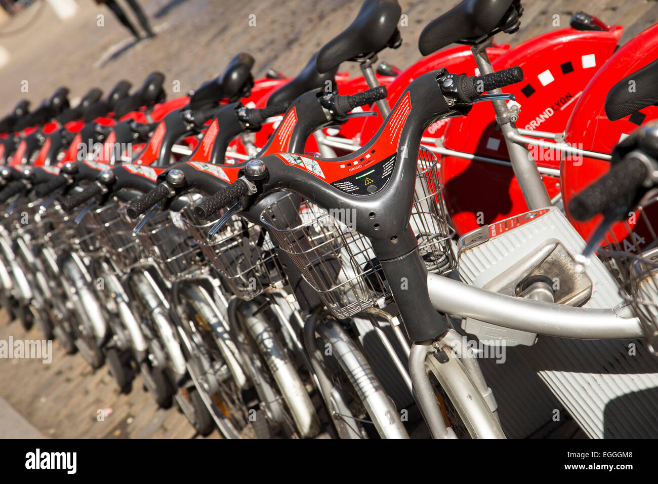 LYON, FRANCE - February, 2015 - Velo'v Grand Lyon shared bikes are lined up in the streets of Lyons, France. - Stock Image