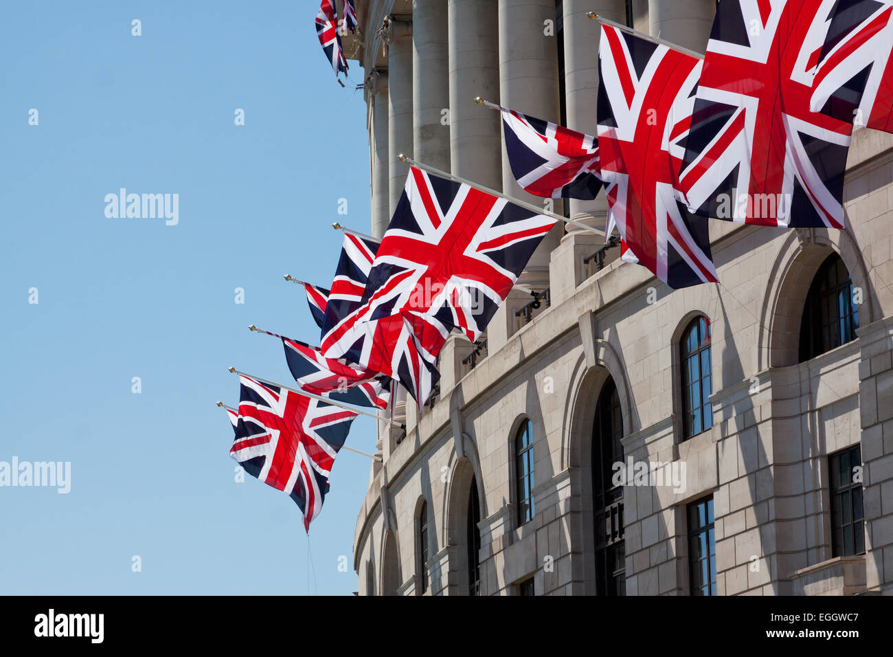 London building decorated with Union Jack flags - Stock Image