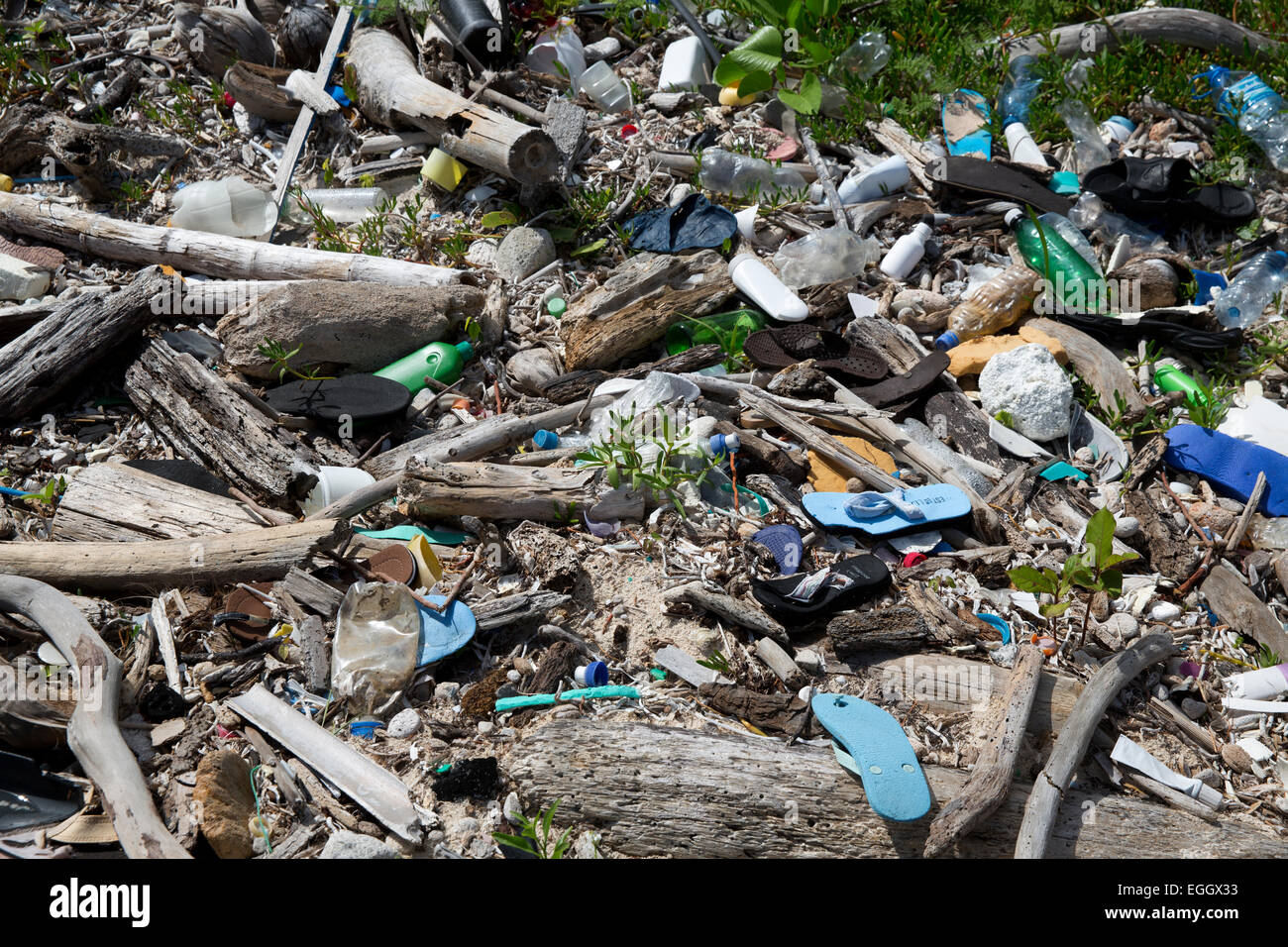 plastic debris pollution on the beach near Mahahual, Quintana Roo, Mexico - Stock Image