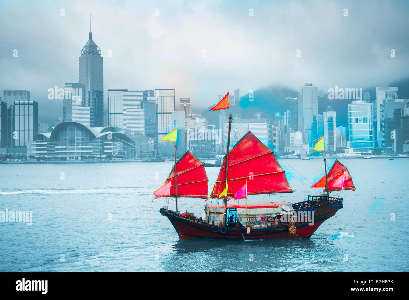 Symbol of Hong Kong - traditional wooden sailboat in Victoria harbor. - Stock Image