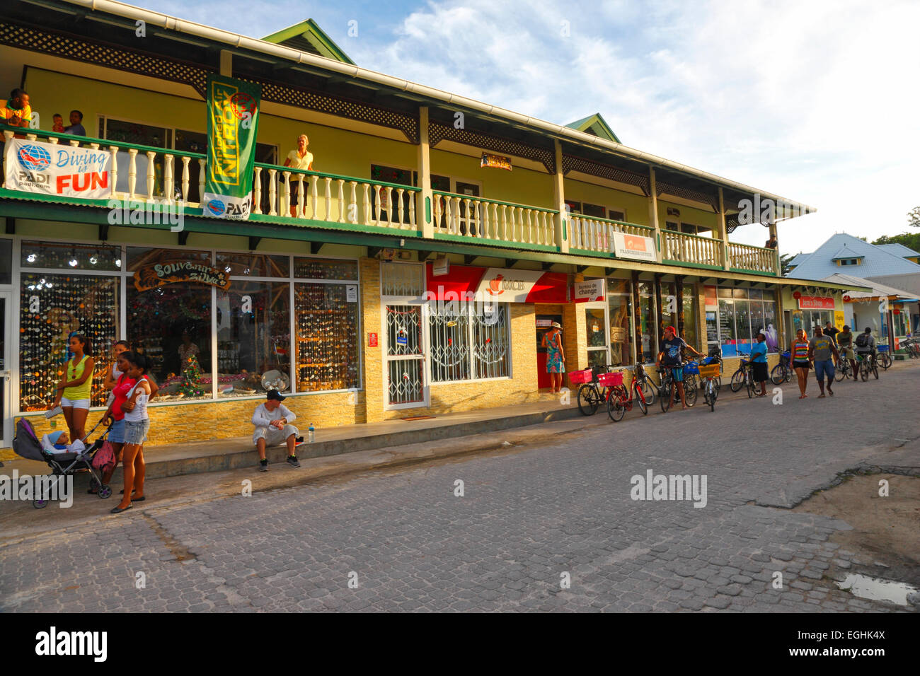 Seychelles, La Digue. The main street and local houses. - Stock Image