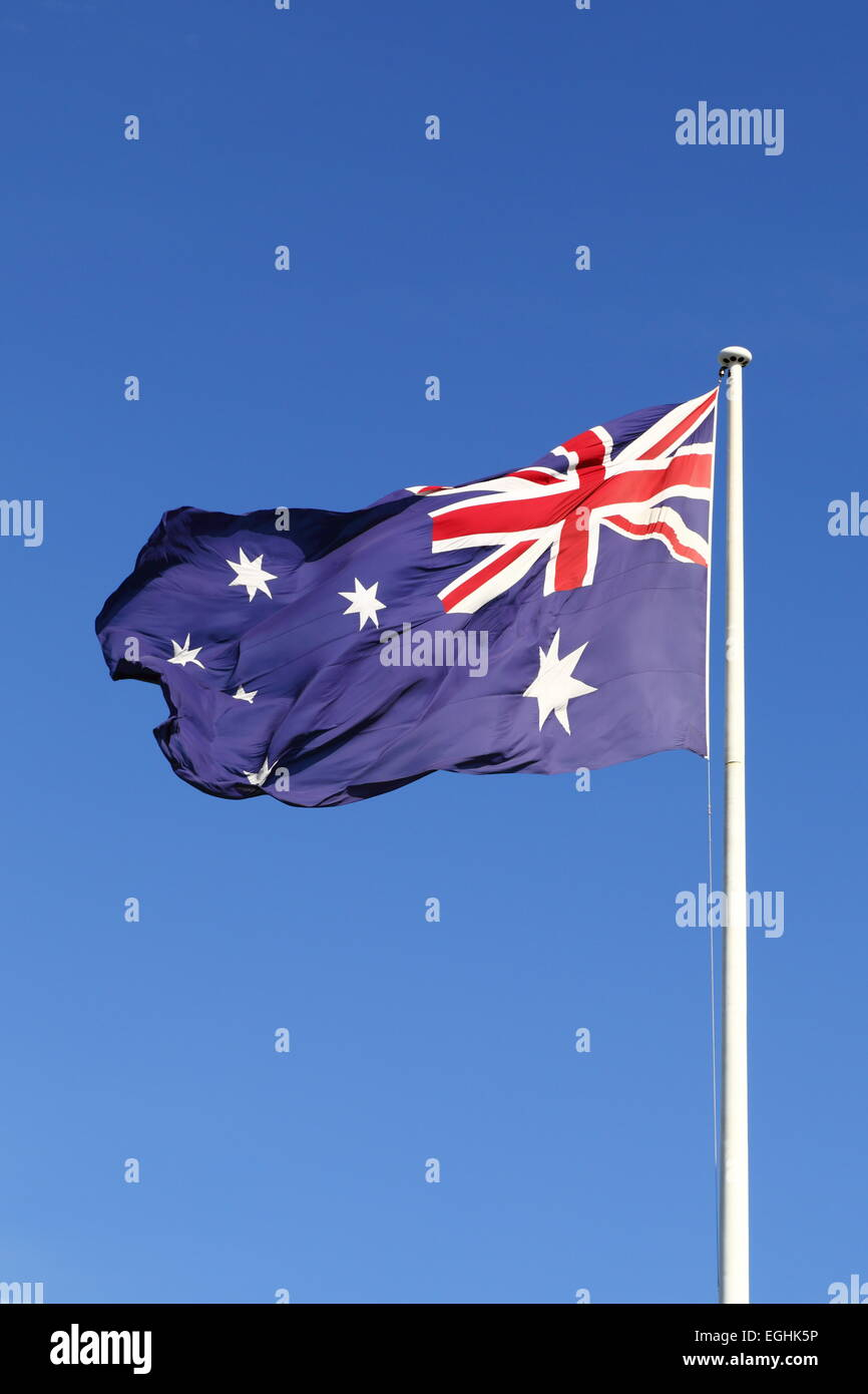 The Australian Flag flying proudly from the Bicentennial Flagpole on Cockle Bay - Darling Harbour, Sydney, NSW, - Stock Image