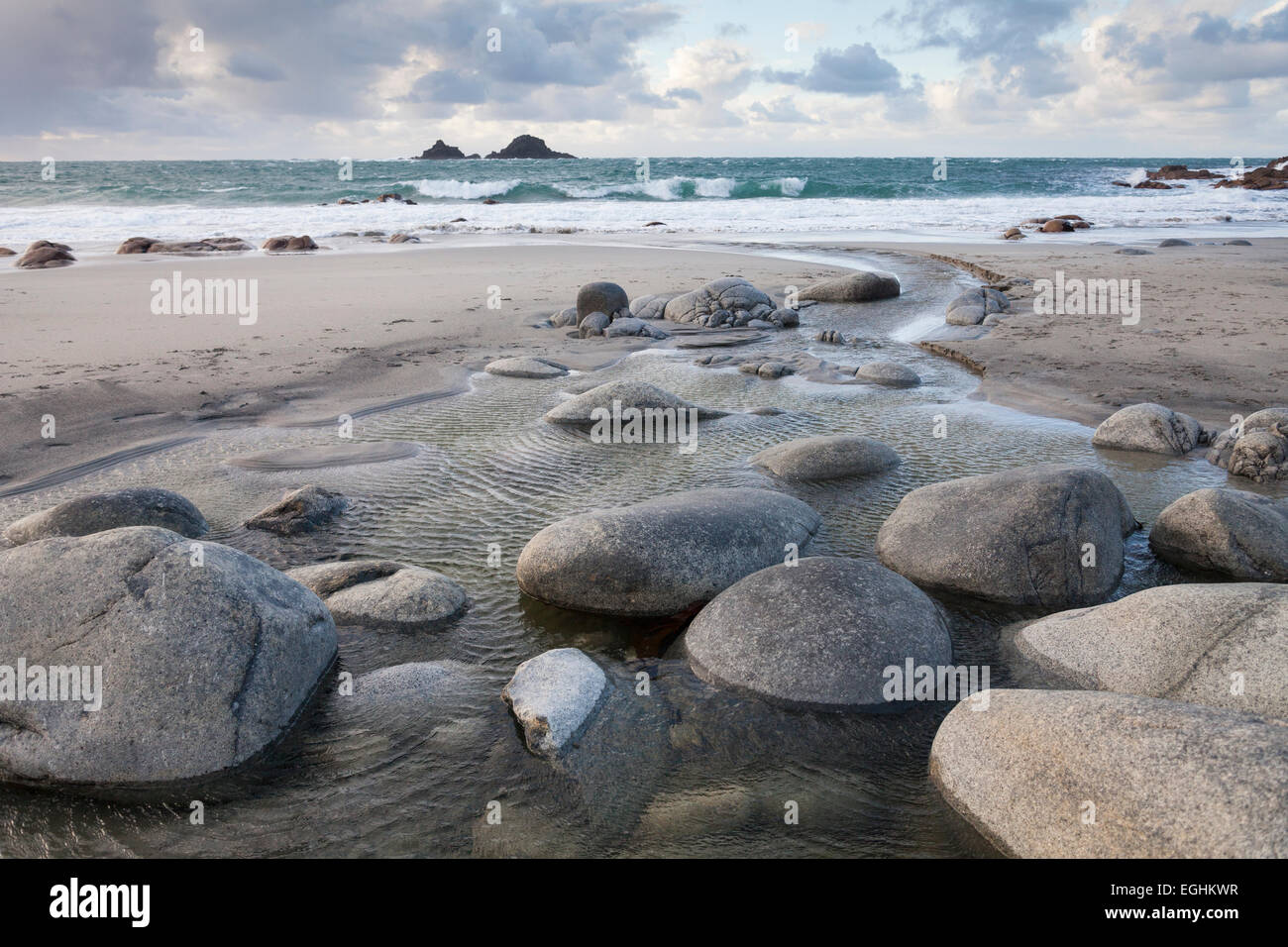 """Rocks in freshwater stream flowing to sea, """"Porth Nanven"""" beach and the Brisons, """"Cot Valley"""", Cornwall, England, Stock Photo"""
