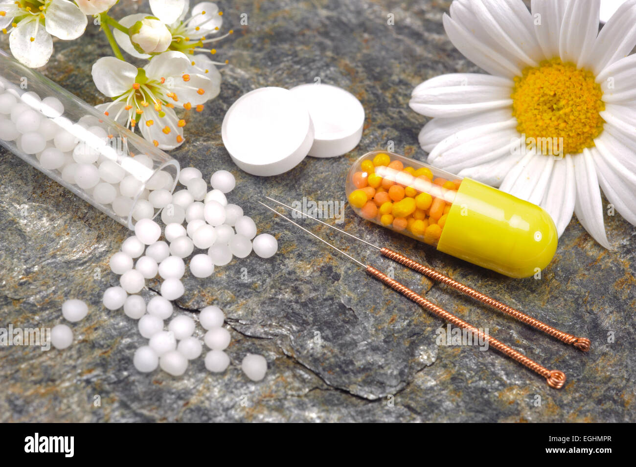 alternative medicine with herbal pills and acupuncture - Stock Image