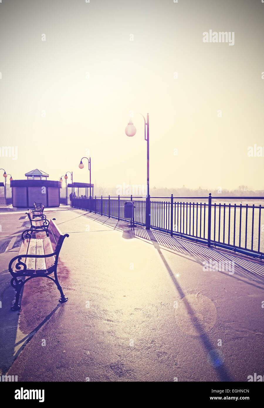 Retro vintage filtered nostalgic picture of promenade with lens flare. - Stock Image
