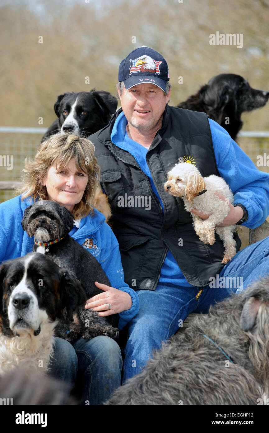 Owners of the Many Tears Animal Rescue centre near Llanelli, S. Wales UK, Sylvia and Bill Van Atta with some of - Stock Image
