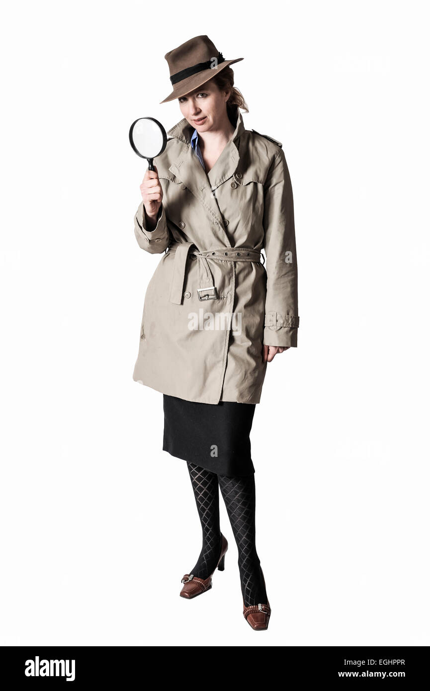 Woman posing as a detective - Stock Image