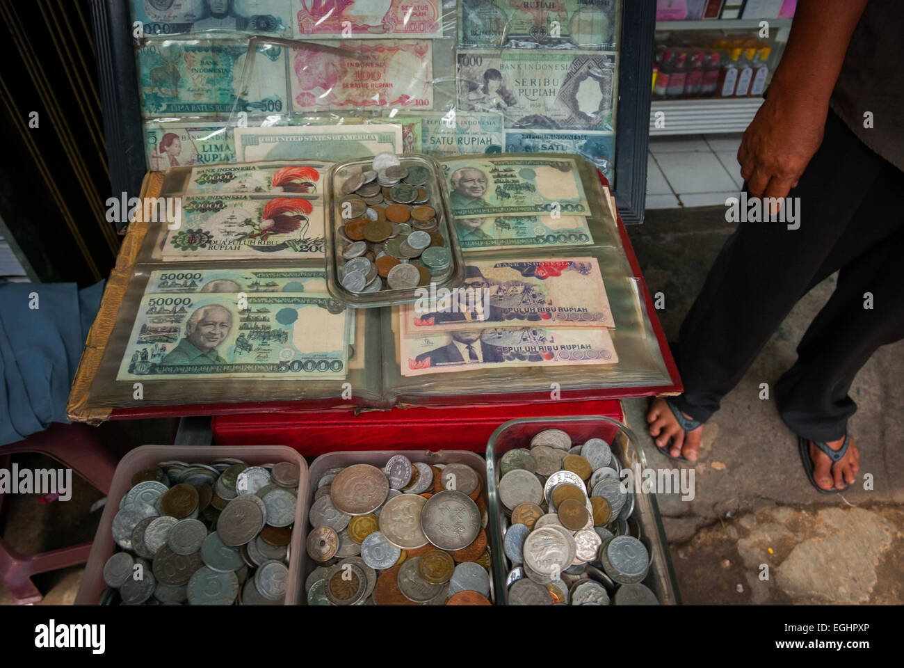 Old (withdrawn, expired) Indonesian moneys are being sold as collector items at a local market in Jakarta. - Stock Image