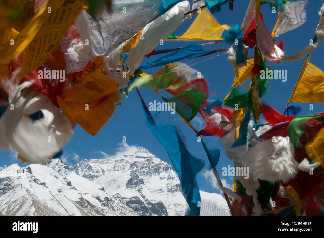 Prayer flags backdropped by Mt. Everest, Tibet - Stock Image
