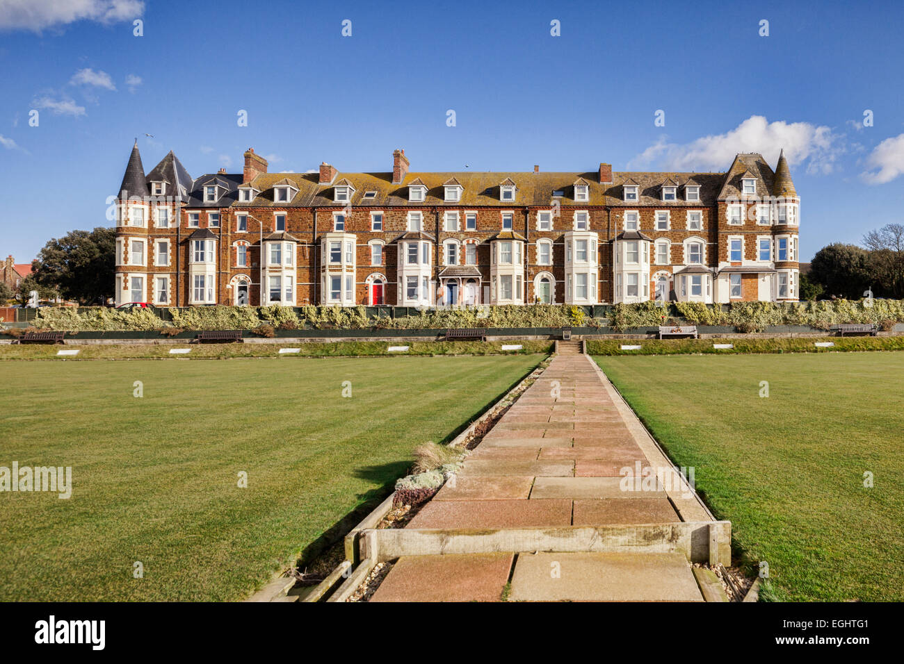 Cliff Parade bowling green and terrace of houses at Hunstanton, Norfolk. - Stock Image