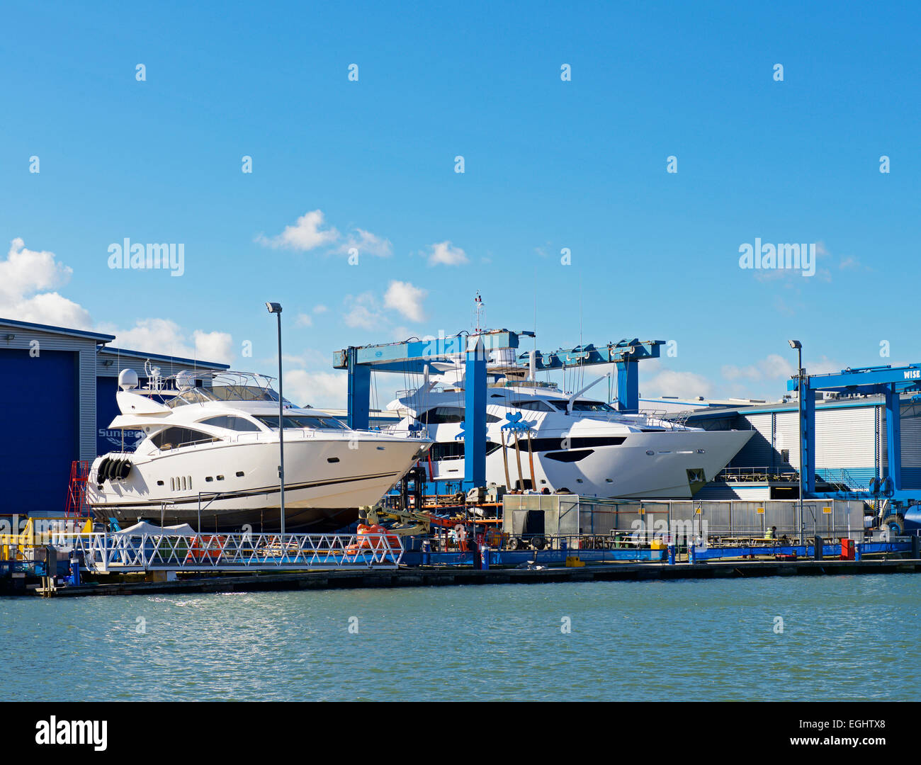 The quay at Poole, Dorset, England UK, with boat lifts - Stock Image
