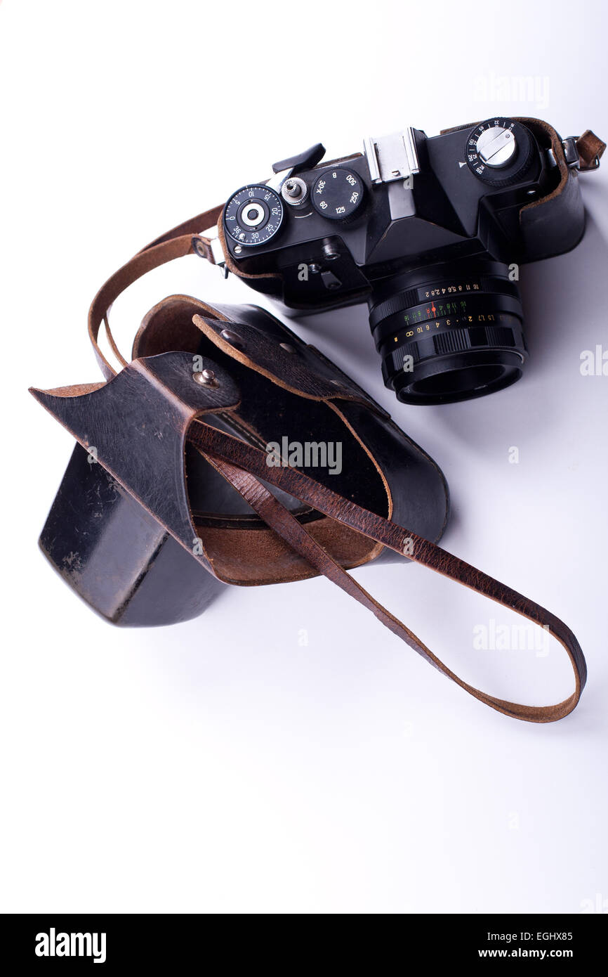 old soviet film camera with leather pouch on white background - Stock Image