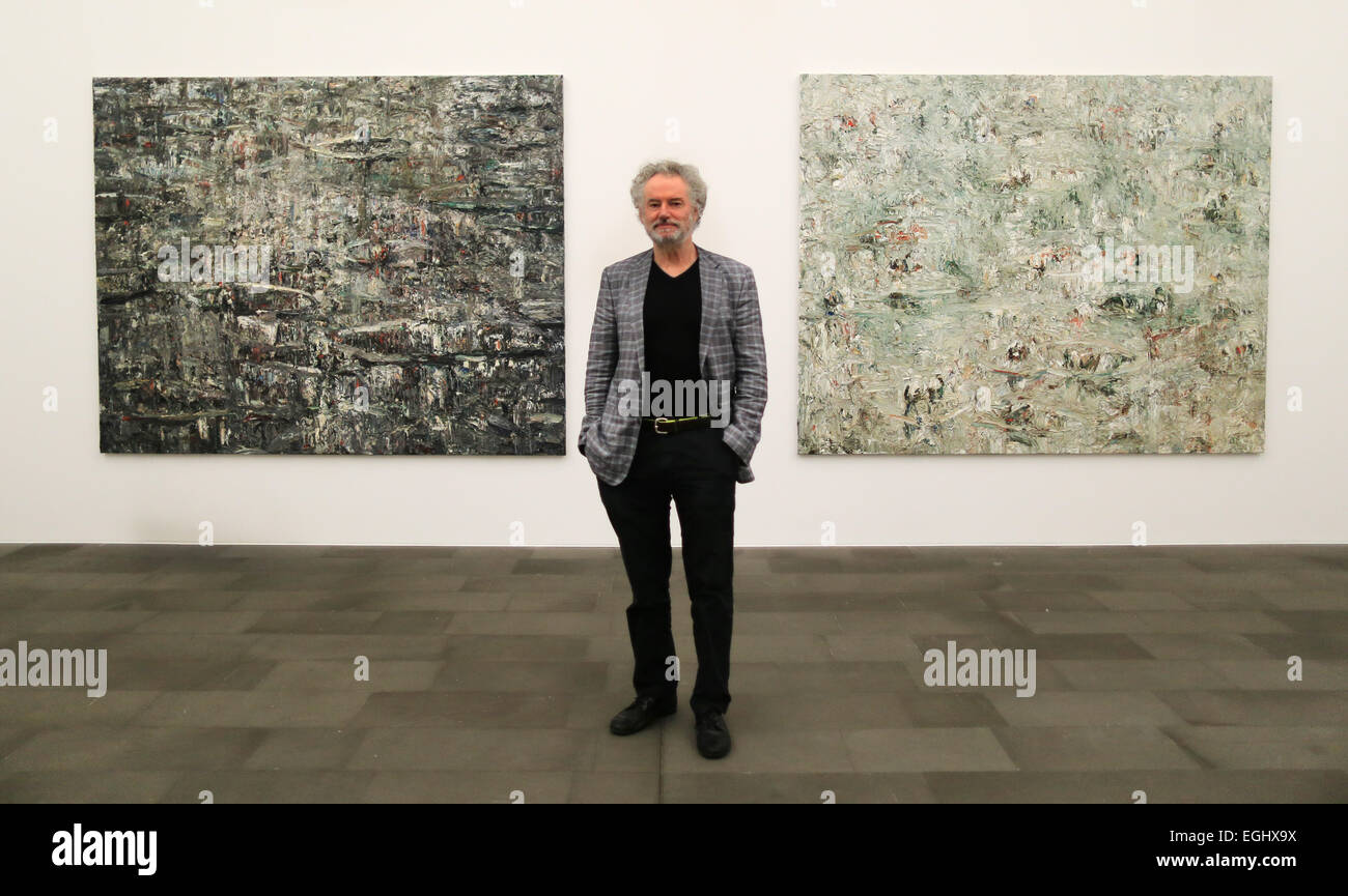 Duisburg, Germany. 25th Feb, 2015. German artist Ralph Fleck stands in front of his paintings at the Kuppersmuehle - Stock Image