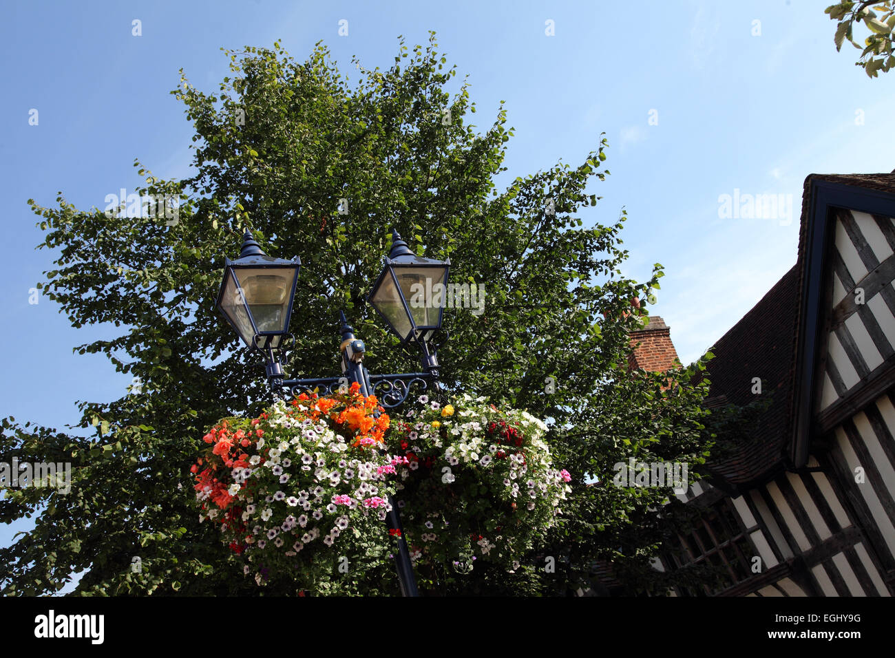 Bunting and floral decorations, hanging baskets on the High Street, Solihull - Stock Image