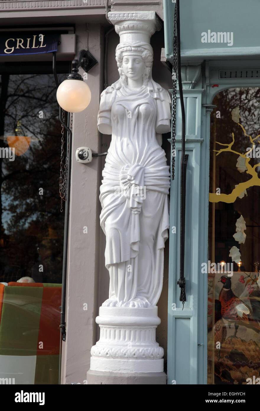 Caryatid statue outside a shop in Montpellier, Cheltenham - Stock Image