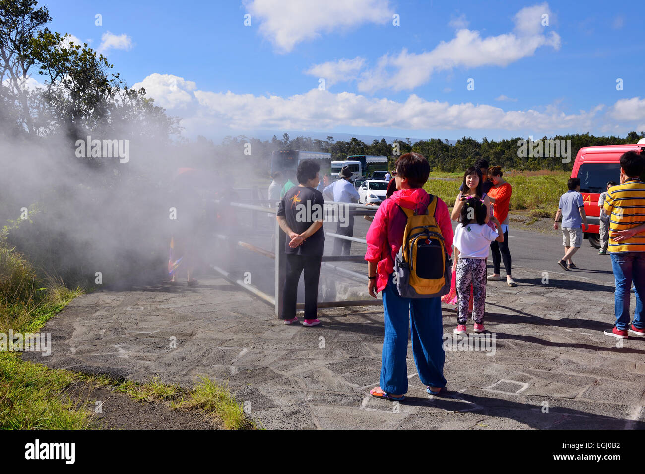 Tourists at steam vent in Volcanoes National Park on Big Island, Hawaii, USA - Stock Image