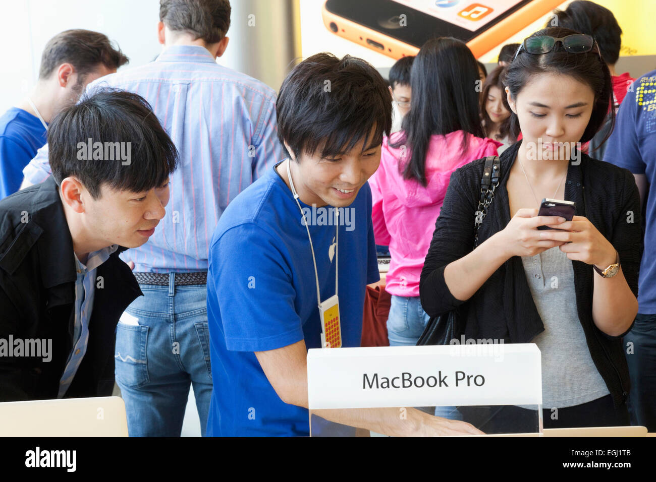China, Hong Kong, Apple Store, Customers Looking at Apple