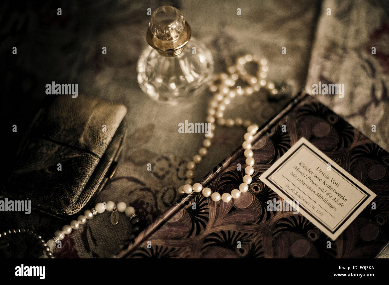 Still life with Flacon and pearl necklace, - Stock Image