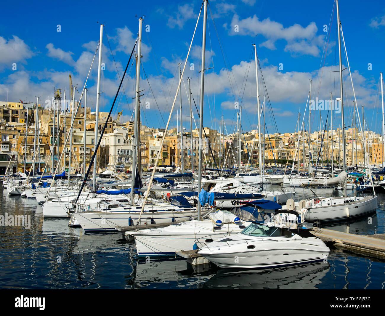 Boats in the marina of Vittorioso, view of Valletta, Malta - Stock Image