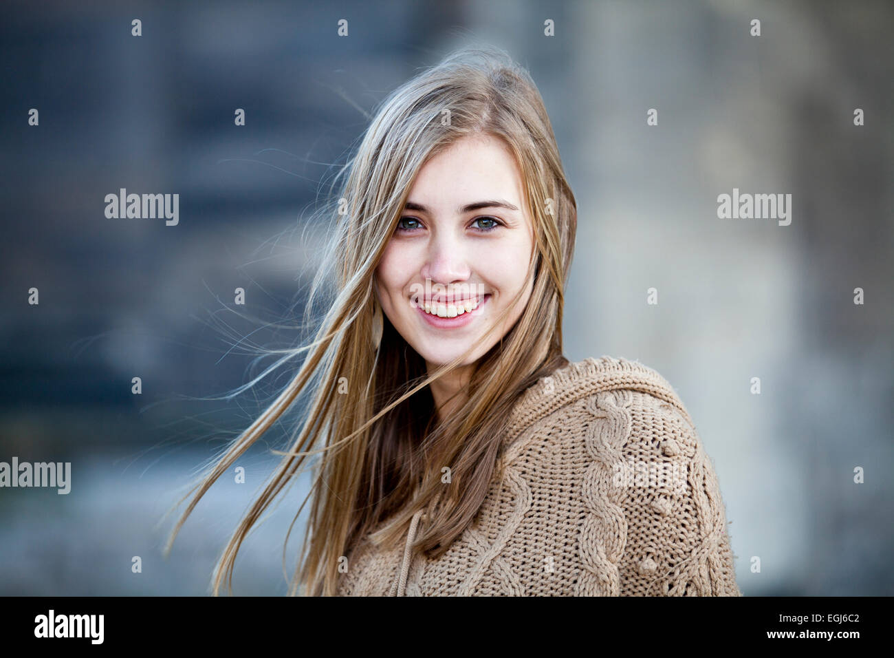 Portrait of a young woman, smile, beaming with joy - Stock Image