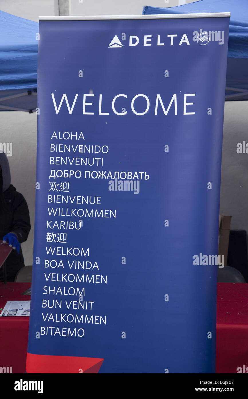 the word Welcome in many languages  promoting all the different countries Delta Airlines flies to. Booth during - Stock Image