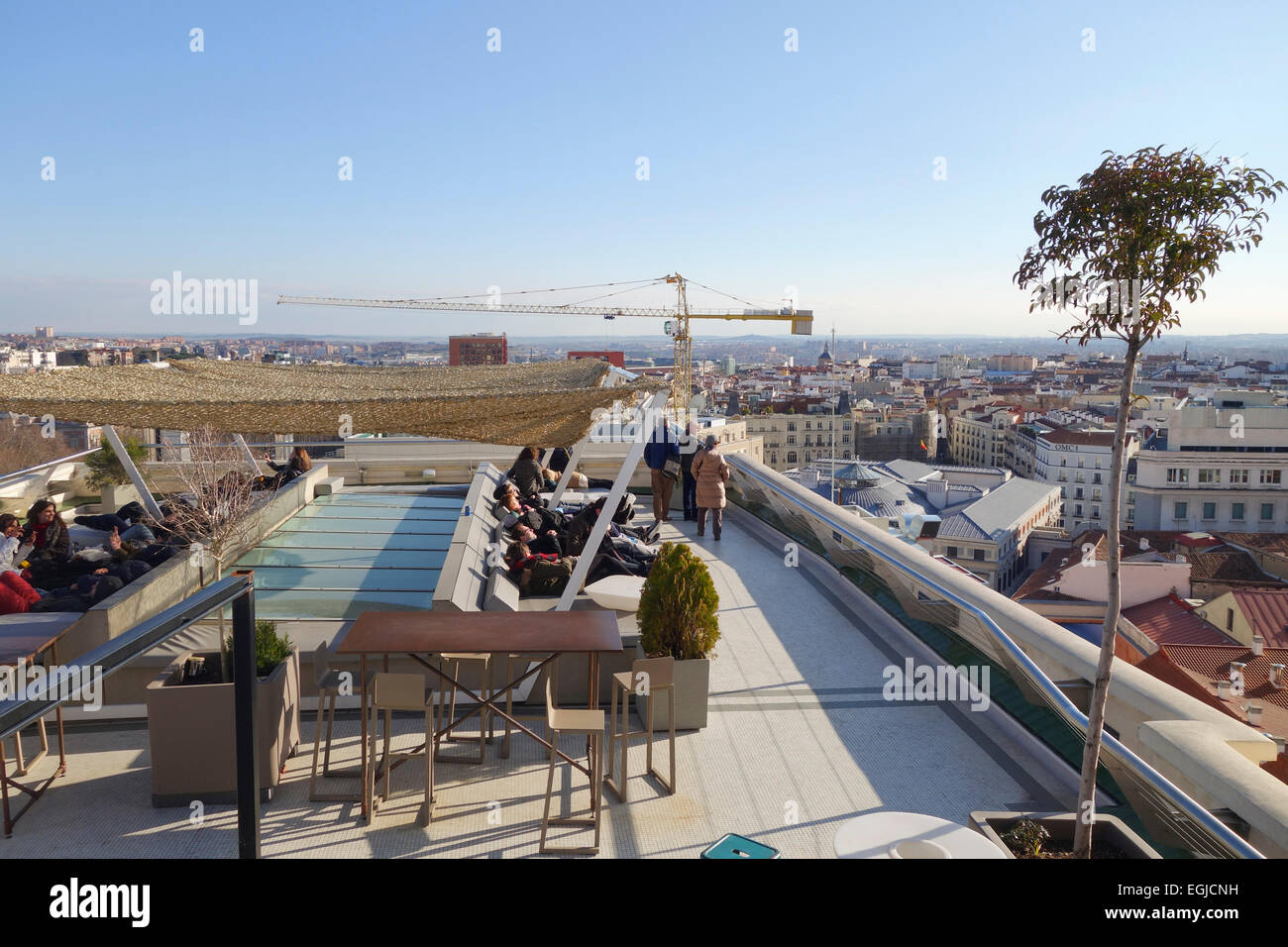 Visitors Relaxing On Rooftop Terrace Loungers Of Circulo De