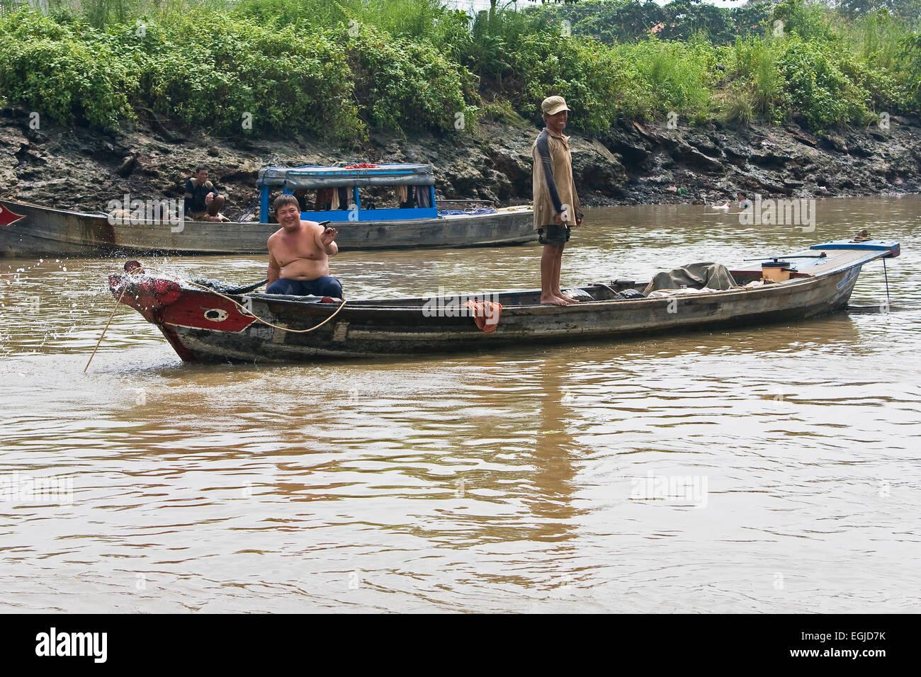 Vietnamese men on a boat on the Saigon River, Saigon, Ho Chi Minh City, Vietnam, Asia - Stock Image