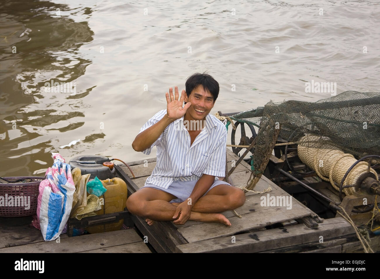 Boat sells goods on the Mekong River in Cai Be, Vietnam, Southeast Asia - Stock Image