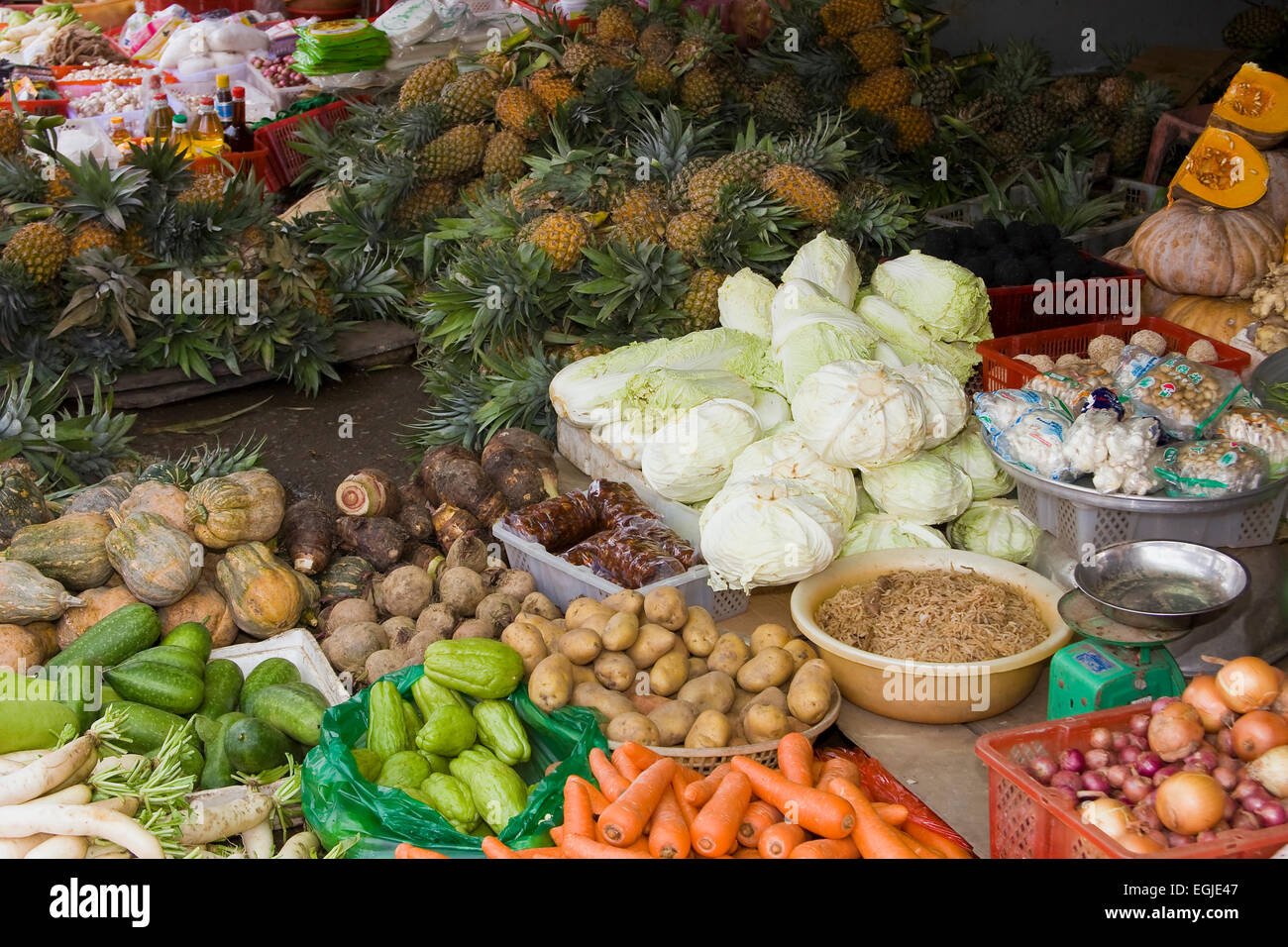 Vegetable stall at the market in Cai Be, Mekong Delta, Vietnam, Southeast Asia - Stock Image