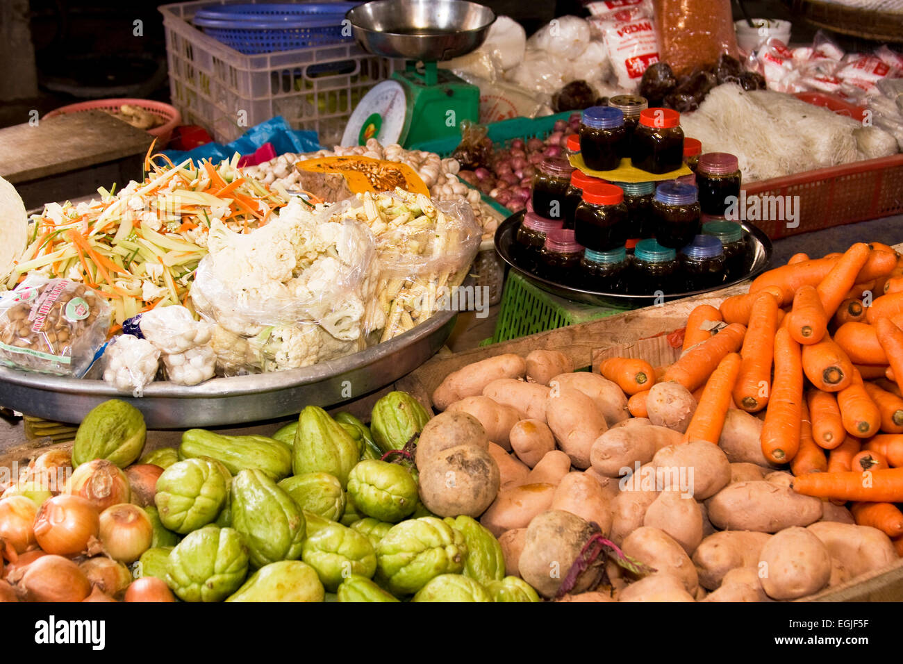 Selling vegetables at a market in at Toi on the island of Phu Quoc, Vietnam, Southeast Asia - Stock Image