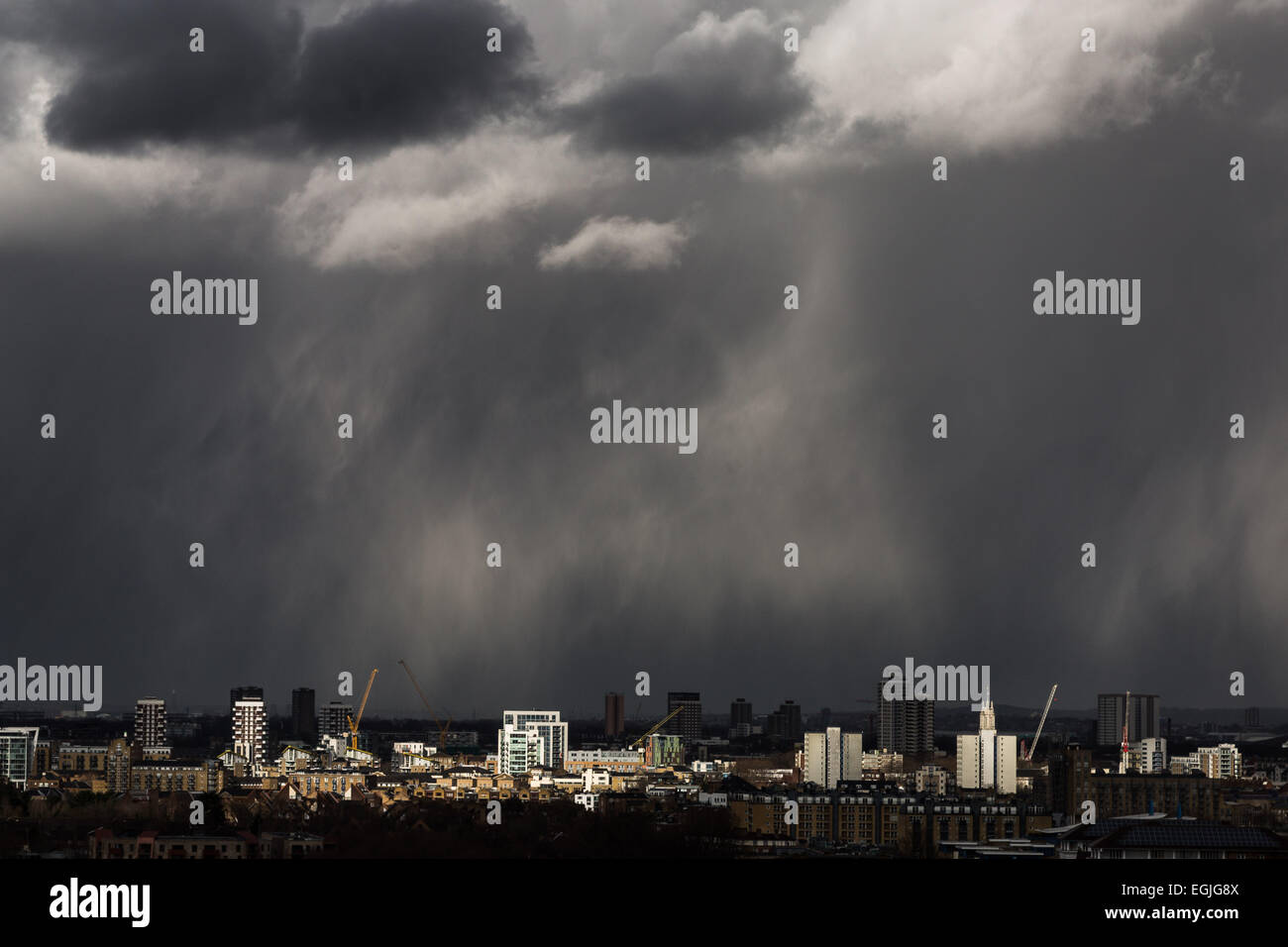 Dark storm clouds, heavy rain with sun break moves across central London - Stock Image
