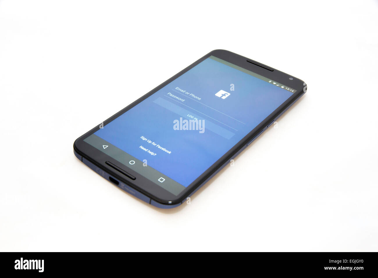 Touchscreen smartphone showing the Facebook login screen - Stock Image