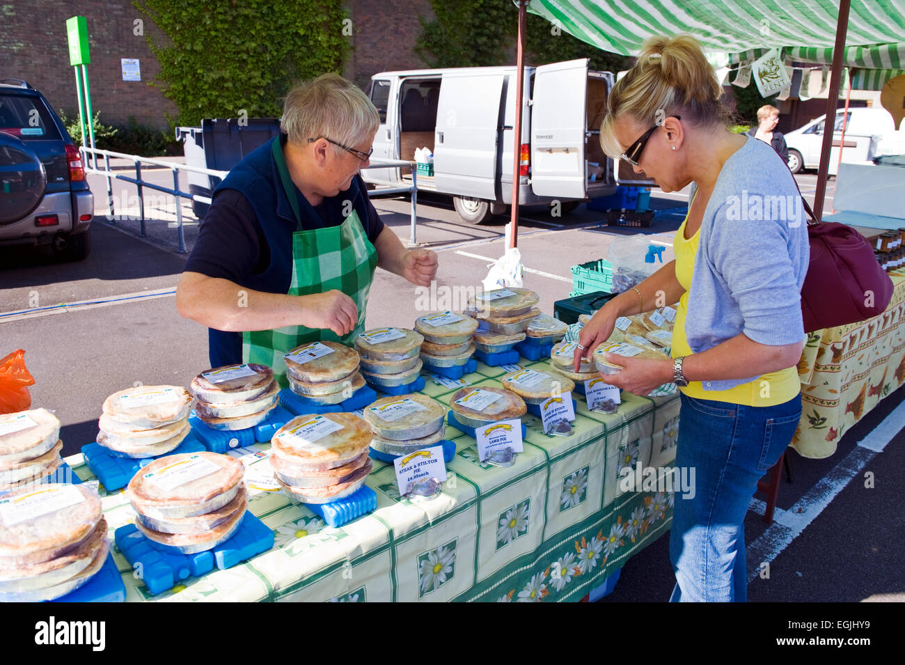 woman buying home made pies at a farmers market - Stock Image