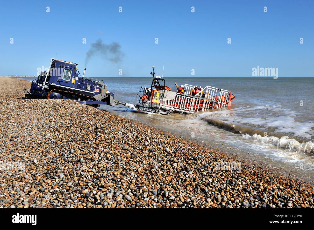 tractor retrieving lifeboat from the sea - Stock Image