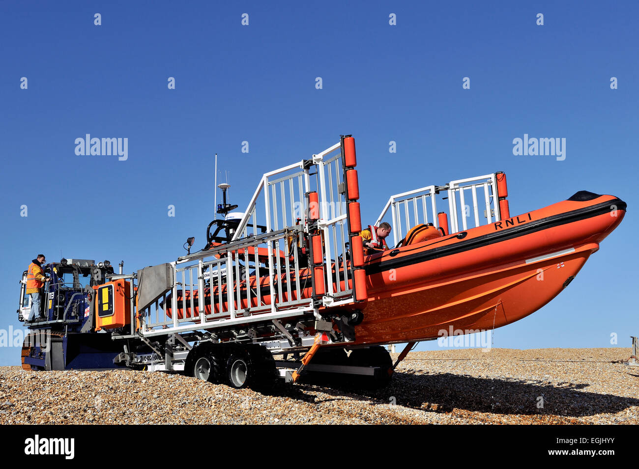 tractor retrieving lifeboat from the sea Stock Photo