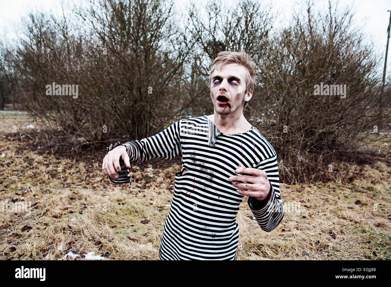 Dressed like sailor man acting creepy zombie Stock Photo