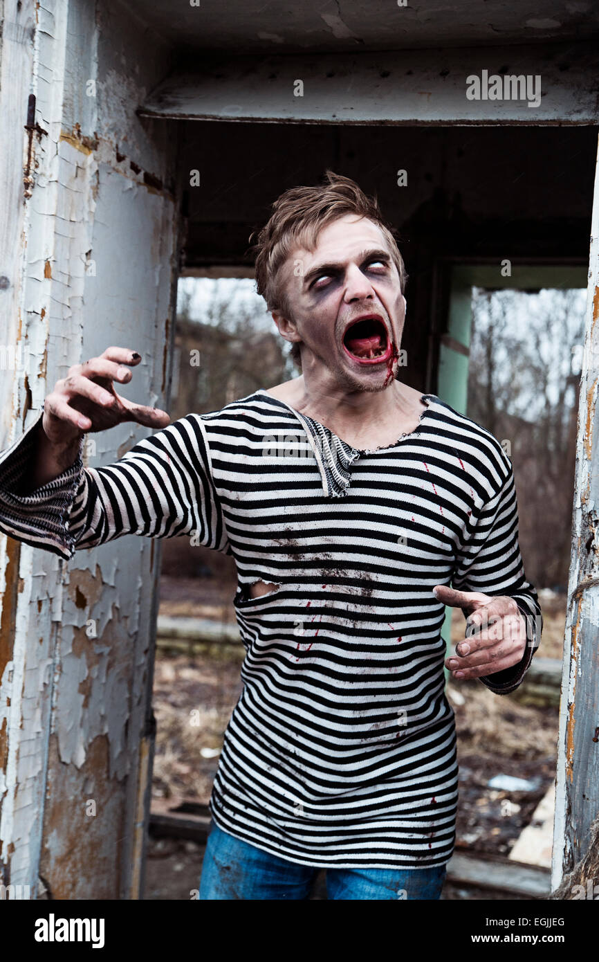 Halloween style dressed man acting like crazy - Stock Image