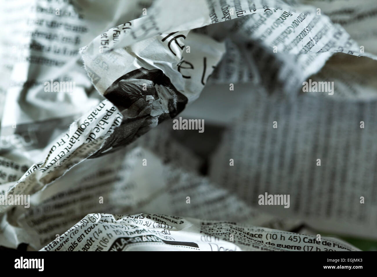 Focus on a French torn and crumpled newspaper - Stock Image