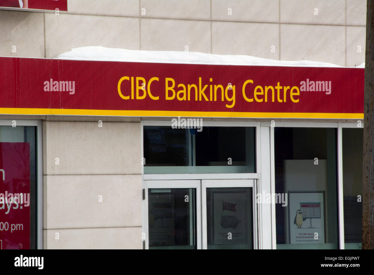 CIBC banking center sign on a retail branch in Toronto Canada - Stock Image