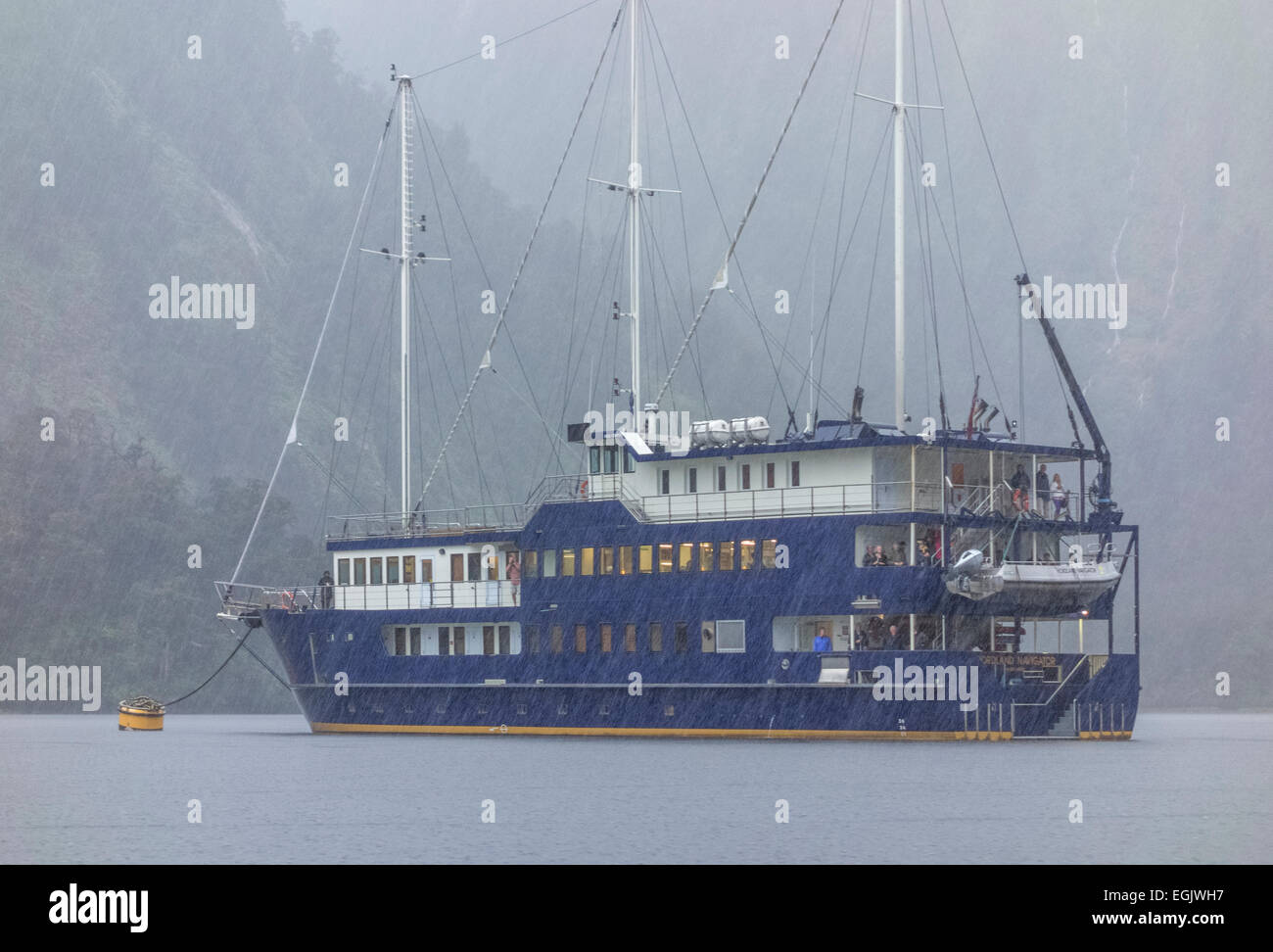 Overnight Doubtful Sound Cruise in the pouring rain in Fiordland National Park New Zealand. One of the wettest places - Stock Image