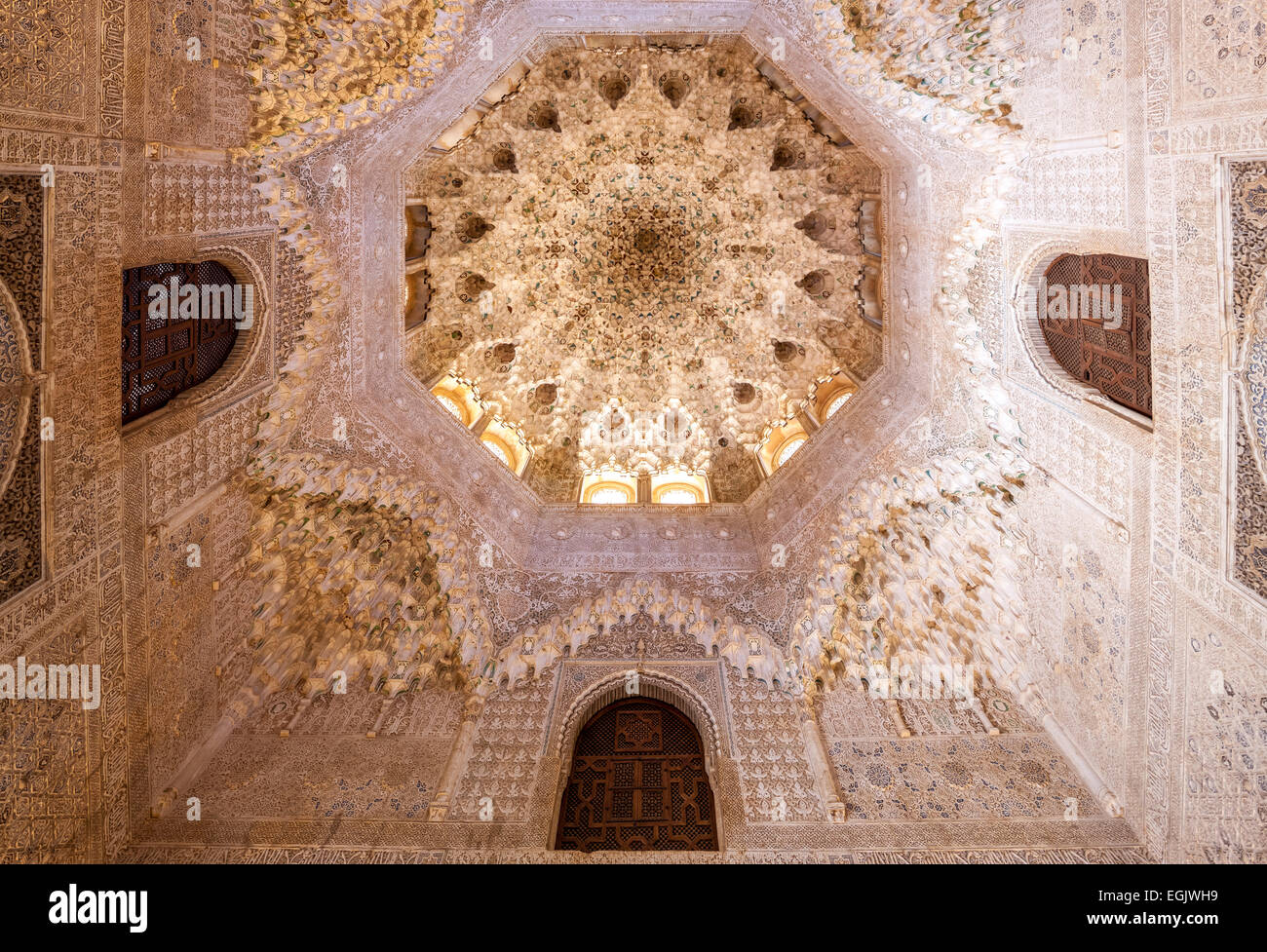 Alhambra Granada Spain. Cupola with decorated vaulted stalactite ceiling in Hall of the two Sisters or  Sala de - Stock Image