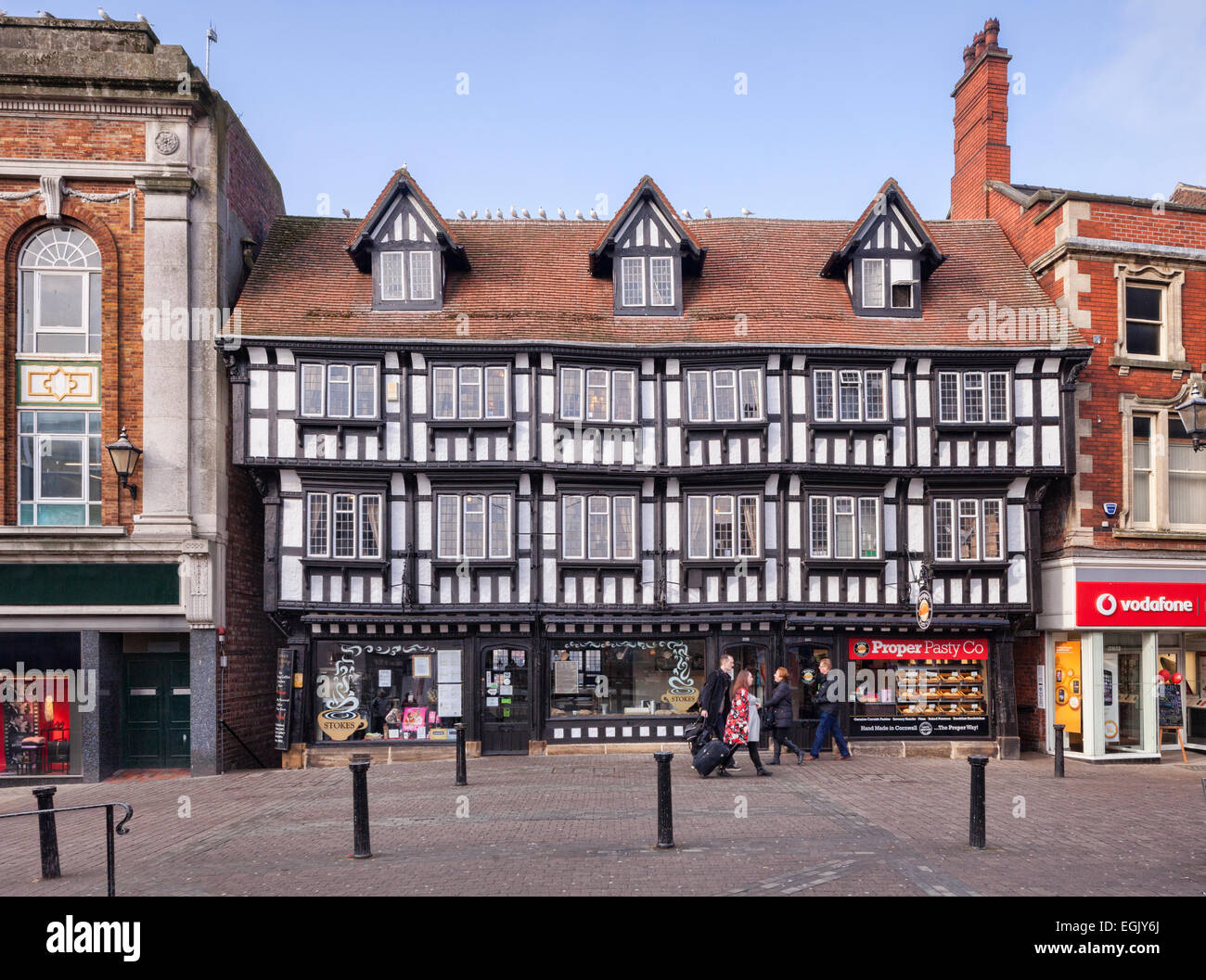 A medieval building housing shops in Lincoln High Street. - Stock Image