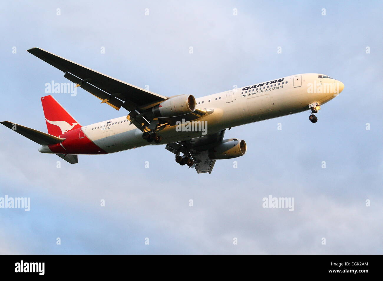 Qantas airplane flying in the sky - Stock Image