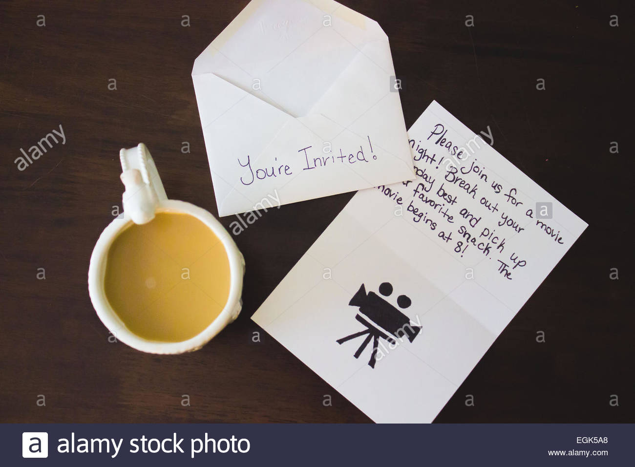Invitation and coffee - Stock Image