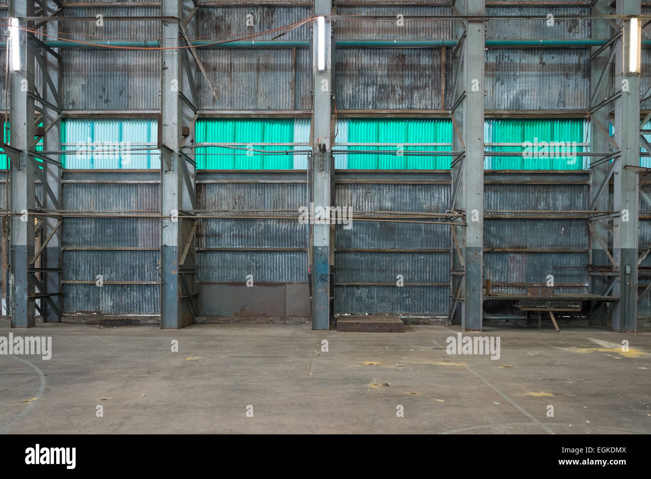 Corrugated iron wall in a warehouse. - Stock Image