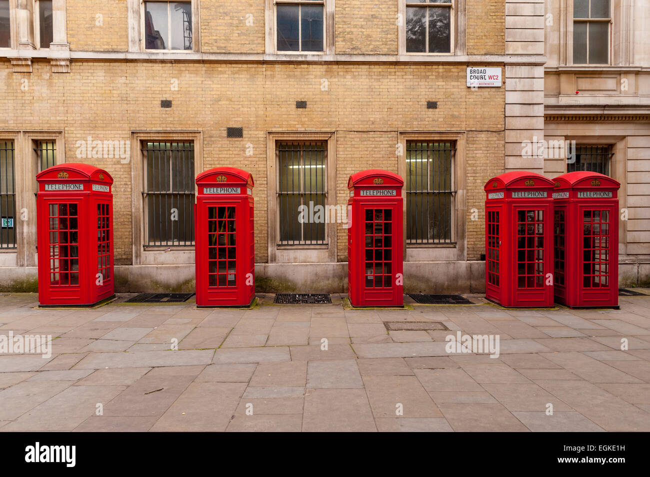 Row of red phoneboxes in Broad court, Drury lane London - Stock Image