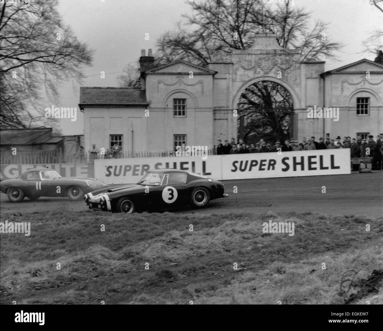 Ferrari 250 SWB spins as Jaguar E type passes. - Stock Image